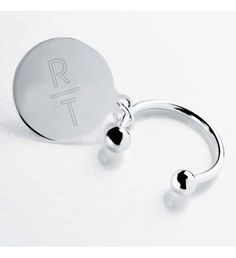 This silver plated keychain includes a simple round disk, measuring 1 ¼ inches in size, with space for two initials. End ball comes off to easily add or subtract keys.