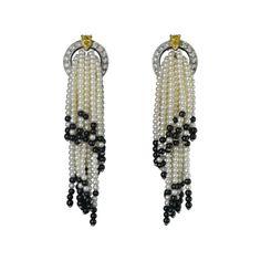 Cultured pearls, yellow diamonds, onyx, diamonds, platinum. Cartier