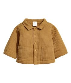 Mustard yellow. BABY EXCLUSIVE/CONSCIOUS. Lightly padded jacket in soft, crinkled, double-weave fabric made from organic cotton. Collar, buttons at front,