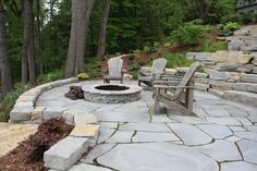 Gorgeous Blue River Flagstone creates an inviting and cozy patio and fire pit.