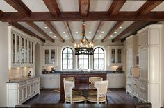 A Georgia coast European classic painted kitchen with an Ivory glaze. ARCHITECT: Keith Summerour. DESIGNER: Liza Bryan Interiors. BUILDER: Pease Construction, Inc.