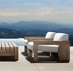RH's Bardenas Lounge Chair:The vast, minimalist beauty of the desert landscape provided the inspiration for this collection designed by Marmol Radziner. Crafted from premium teak, the low-slung, linear profile and squared-off form features deep seats and generously padded cushions.