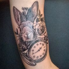 Woodcut style bunny, pocket watch and rose upper arm tattoo by Ryan Kaufman…