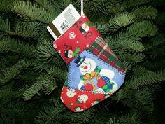 One of a kind handmade patchwork quilt holiday stocking giftcard holder ornaments, set of 10   https://www.etsy.com/listing/257657200/handmade-quilted-patchwork-stocking-gift