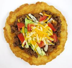 Indian Tacos~Indian tacos AKA Navajo tacos are like tacos but made with Indian frybread (AKA Navajo frybread) in place of the tortilla. They are drop-dead delicious. (And pretty much drop-dead unhealthy due to the frying and the, uh … all the Indian Taco Recipes, Mexican Food Recipes, Beef Recipes, Dinner Recipes, Cooking Recipes, Ethnic Recipes, Cooking Time, Easy Recipes, Breakfast