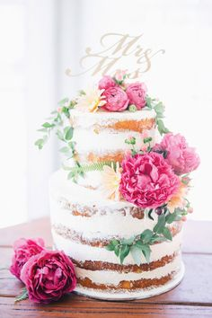Naked wedding cake with pink and peach flowers and 'Mr & Mrs' wooden topper | Ben Yew Photography | See more: http://theweddingplaybook.com/14-amazing-wedding-cakes-to-tantalise-your-tastebuds/