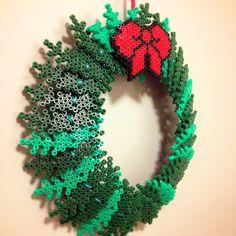 Christmas wreath hama perler beads by idamariaringh - Pattern: http://www.pinterest.com/pin/374291419002724088/