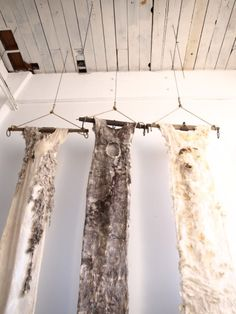 The Hungry Girls, a collection of 9 foot tall fiber and mixed media dresses hanging from old, weathered wood and metal yokes, were inspired by Moira Bateman's fascination with the images in Patricia Eakins' story The Hungry Girls.