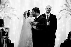 Bride and groom's first kiss at Langley Hall in Maumee, Ohio.