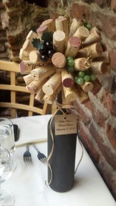 Cork ball embellished with mini grapes top a chalkboard painted wine bottle. This was used as a shower centerpiece, but look stunning on a shelf or end table