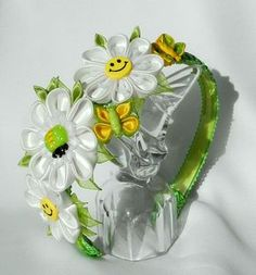 Bright flowers, spring mood, smiles at the daisies, butterflies, candy. This headband that will suit cheerful girl.