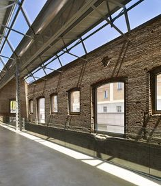 refurbishing a former industrial building, spanish architect rafael de la hoz has completed the daoiz y velarde cultural center in madrid. Industrial Architecture, Architecture Old, Contemporary Architecture, Architecture Details, Monuments, Madrid, Warehouse Design, Building Renovation, Adaptive Reuse