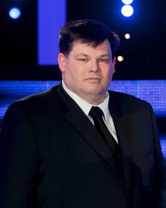 """The Chase - Mark Labbett is """"The Beast,"""" one of the finest quiz brains in the country, an intellectually dominating and supremely self-confident quiz genius. The Chase isn't just a quiz; it's a race, where the contestants must avoid being caught by the Beast. Stay ahead and they could win a lot of money; get caught and they lose it all!"""
