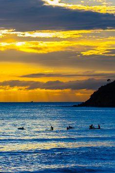 Surfers at sunrise, Manly Beach, Sydney, New South Wales, Australia | Blaine Harrington III