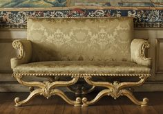 Gilt X-frame sofa, 1735-40, in the style of William Kent and with velvet upholstery, in the Volury Room at Ham House.