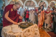 His Holiness the Dalai Lama cuts the first birthday cake of his 80th year to share with Indian friends in New Delhi, India on March 22, 2015. (Photo by Tenzin Choejor/OHHDL) On a personal note- We share the same day of birth.
