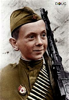 Young Soviet Soldier carrying an MG 34.  It looks like he has already been given a medal for bravery in combat.