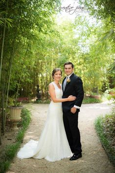 A beautiful couple under our bamboo walkway in the gardens. Get more information at thethompsonhouseandgardens.com.