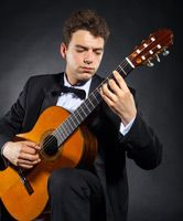 Man playing guitar with Butterfly Finger Picks