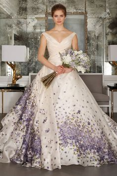 Go beyond the white dress. Strut down the aisle in color with a dress like this Romona Keveza gown!