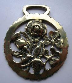 Horse brass featuring thistle, rose and shamrock.