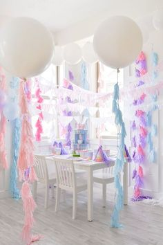 Large balloons and fringe tassels from the Little Llama First Birthday Party via Kara's Party Ideas #orientaltrading #AD #llamaparty #llamabirthdayideas #karassignatureparty