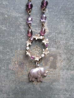 Elephant Charm Necklace / Vintage Assemblage by hollyglimmer