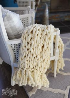 The Eggnog Arm Knit Blanket is a beautiful free knitting pattern featuring a lovely fringe detail. The best part is this fringed arm knit blanket can be made in a couple of hours. You will love snuggling up by the fire with this piece.