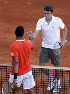 Gilles Simon of France (R) shakes hands with fellow countryman Jo-Wilfried Tsonga after their quarter-final match of the Monte Carlo Masters in Monaco April 20, 2012. Simon defeated Tsonga.