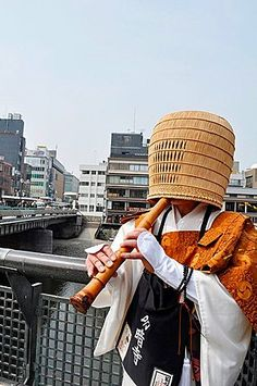 Japan, Kyoto, a monk playing a flute in Gion