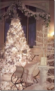Gorgeous white Christmas tree, sleigh and snow that gives you an overall wonderful wintry feeling.
