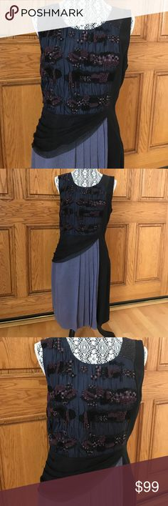 EUC Anthropologie special occasion dress size 12 Anthropologie beaded & embroidered navy & black special occasion dress in ladies size 12. Made by Moulinette Souers, this gorgeous showstopper features a black tulle swag artfully draped over a contrasting lavender skirt with five knife pleats plus elegant beading & embroidery on the bodice to make you feel extra glam. See photos for these beautiful details & to assess excellent pre-loved condition(worn once). Thanks for shopping my closet!💕…