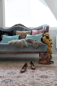 Love the antique sofa with the oriental rug. Am a sucker for blue velvet on antique loveseats.