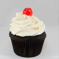 Black Forest--Chocolate cupcake with cherry filling topped with vanilla butter cream frosting.---Sweetly Smitten