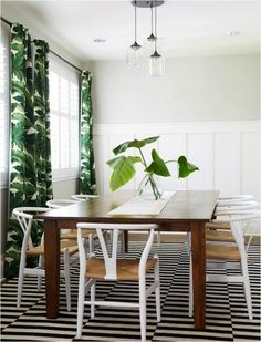 palm print curtains in a white room with stripy black and white (ikea stockholm) rug