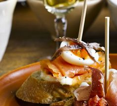 Smoked salmon & quail's egg. Tuck in this pintxos-inspired topped bread dish for a flavour of San Sebastian in northern Spain Quail Recipes, Tapas Recipes, Bbc Good Food Recipes, Egg Recipes, Seafood Recipes, Appetizer Recipes, Spanish Recipes, Savoury Recipes, Cheese Recipes