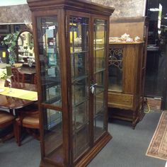Curio / China Cabinet - Oak cabinet with leaded glass doors.  78 inches tall by 44 inches wide.  Glass shelving with interior lights.   Item 702-1.  Price $580.00    - http://takeitorleaveit.co/2014/12/03/curio-china-cabinet/