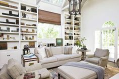 Traditional living room with built in bookcase, sofa, ottoman and dueling armchairs