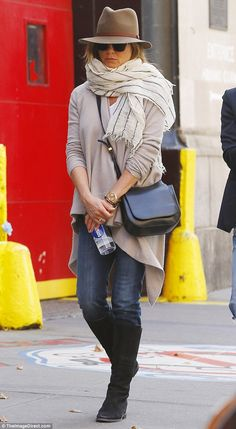 Not the Friend we know: The 46-year-old star opted for a causal look in jeans, knee-high b...