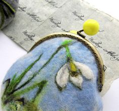 This is a hand felted purse that I have individually designed Felted coin purse with bag frame metal closure . Decor - felted Snowdrops flowers.