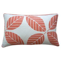 Linen pillow with coral piping.