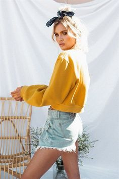 Cosy and on-trend, the Fly Mustard Jumper is made from a super soft, fleecy fabric in a mustard hue. It features a high, rounded neckline with full length sleeves, a relaxed fit and contrast ribbed hem, neckline and cuffs. Pair with a blue denim skirt or high waisted jeans! By Toby Heart Ginger.