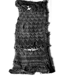 Leap strømpelgg or sleeve with tablet woven borders. Brick discovery from the early Iron Age. Found in Jæren, Rogaland. Stocking or sleeve worked in sprang with a tablet woven edge,  Early Iron Age, Norwegian Folk Museum NF.08455-029.
