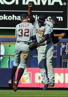 Outfielders Don Kelly #32, Torii Hunter #48 and Austin Jackson #14 of the Detroit Tigers congratulate each other after they defeated the New York Yankees 9-3 in a MLB baseball game at Yankee Stadium on August 10, 2013 in the Bronx borough of New York City. (Photo by Rich Schultz/Getty Images)