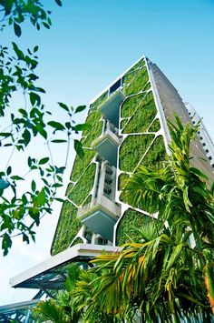 high rise building with garden planter covering entire building with plants