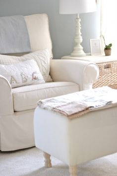 "<pre>This plush rocking chair with knitted pillows from <a href=""http://jennysteffens.blogspot.com.au/2012/01/emmas-nursery-soft-cuddly-nursery-pale.html"" target=""_blank"" rel=""nofollow"">Jenny Steffens</a> looks like the perfect cozy place to cuddle up with my little winter baby!</pre>"