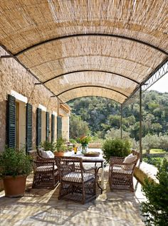 Una Pérgola en el Exterior . . . A Pergola Outdoor - A pergola made ​​of wattle and iron clothe the outside dining. The table, with iron frame and ceramic, is a Moroccan piece. The chairs were purchased at Rialto Living. . . . Una Casa Mallorquina de Obra Nueva (A Mallorcan New House)