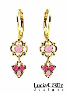 Lever Back Flower Shaped Dangle Earrings by Lucia Costin Made of 14K Yellow Gold over .925 Sterling Silver with Light Pink, Fuchsia Swarovski Crystals and 3 Stones Falling Lucia Costin. $33.00. Dangle ornaments accented with floral design; Unique jewelry handmade in USA; Beautifully crafted with light rose and fuchsia Swarovski crystals; Mesmerizing enough to wear on special occasions, but durable enough to be worn daily; Lucia Costin flower shaped drop earrings