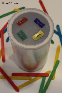 Simple preschool color matching activity that will also work on fine motor skills -- pushing colored popsicle sticks into an old coffee can! This activity not only develop cognitive skills, but and fine motor Motor Skills Activities, Montessori Activities, Infant Activities, Fine Motor Skills, Colour Activities, Toddler Fine Motor Activities, Special Education Activities, Indoor Activities, Toddler Learning