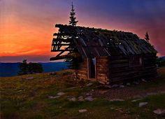Sunrise At Big Baldy Creek Lookout by Kathy Weaver  The sun coming up on an old cabin at Big Baldy Creek Lookout in Montana.